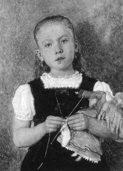 Filllette tricotant