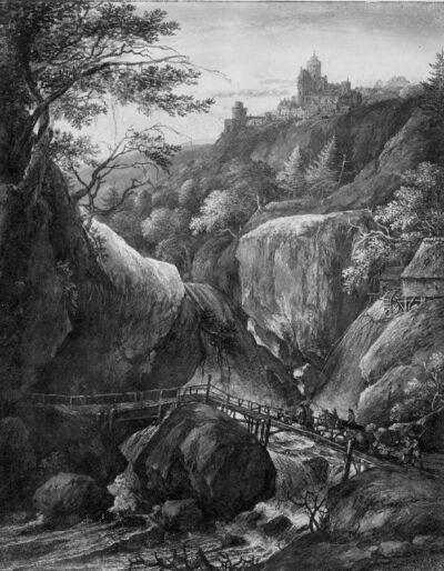 Rotslandschap met waterval en loopbrug