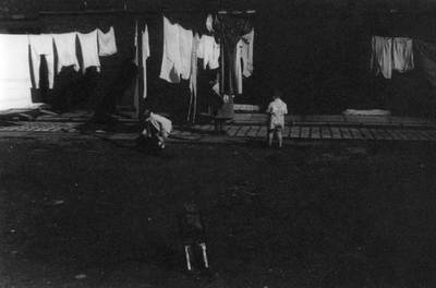 Children playing in the street on washing day