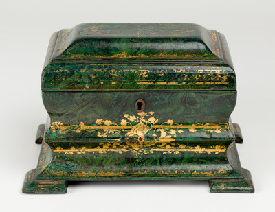 Rectangular tin tea-caddy on feet with two compartments and Malachite imitation green and gold leaf decoration.