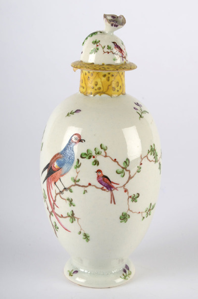 Image from object titled A tall, thin tea canister decorated with exotic birds.