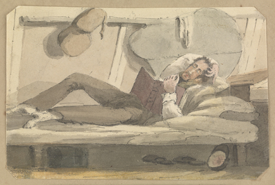 Image from object titled Full length view of man relaxing on a bunk reading a book