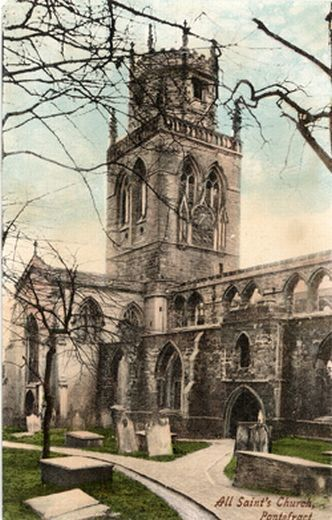 A postcard of the tower of All Saints church. The chamber above the door was alleged to have been used as a schoolroom.