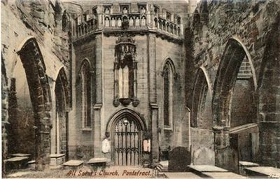 A postcard of the ruins of All Saints's church. This view looks towards the entrance of the new church built across the trancept