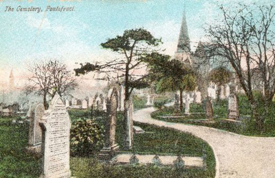 A tinted postcard of Pontefract Cemetery. It shows the gravestones of the Hartley family in the foreground, and the Chapel of Rest in the distance.