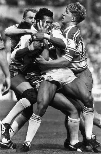 'When push comes to shove', a rugby league clash photographed by Michael Steele.