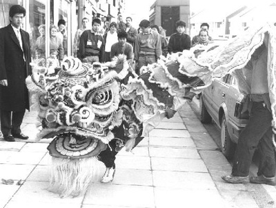 Image from object titled East Ocean staff celebrating Chinese new year with a dragon display. Photograph courtesy of the Pontefract and Castleford Express.