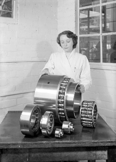 Image from object titled Woman putting large bearings into a mould at RHP.