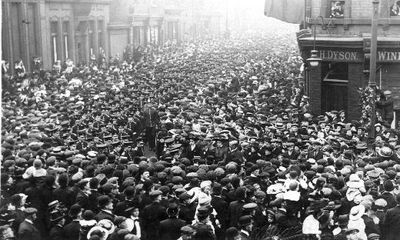 Crowds in Wood Street watching a military parade.