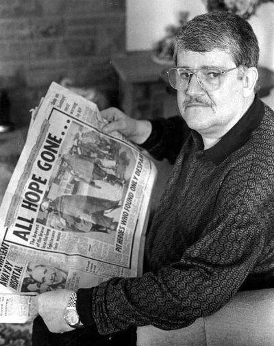 Image from object titled This press photograph shows Bill Morley, a member of the Lofthouse Pit Recue Team, reading newspaper coverage on the anniversary of the disaster in 1993.