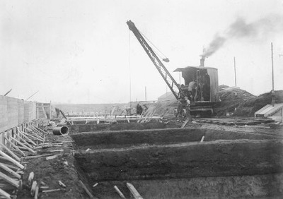 Image from object titled Steam crane at work at the Calder Vale Road sewage works around 1930.