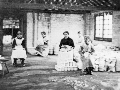 Image from object titled Women and girls at work in a ceramics factory, 1890 to 1920.