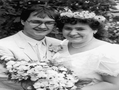 Vivian Young and Nigel Rollin marrying at Womersley Church on 16th August, 1986.
