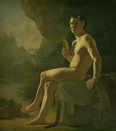 Ung Pan i en grotte. Modelfigur