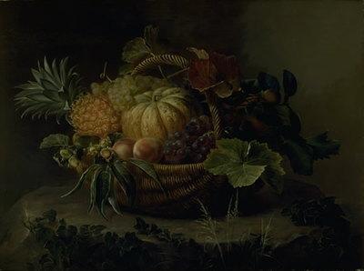 En kurv med frugter på en træstub