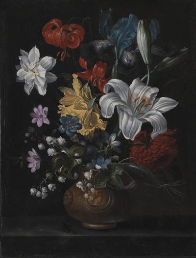 En stentøjskrukke med blomster