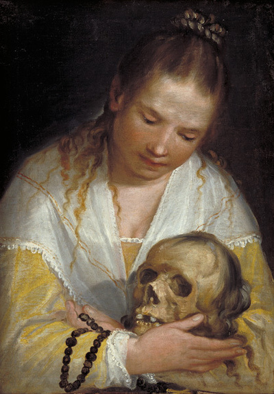 A Young Woman Contemplating a Skull