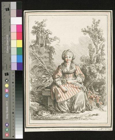 Kobieta z koszem kwiatów siedząca w ogrodzie