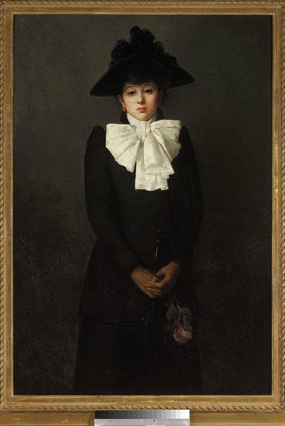 Portret młodej kobiety z różą w ręku