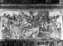 Freskenzyklus mit Passionsszenen — Wandfelder: Kreuzlegende — Christus wird ans Kreuz genagelt