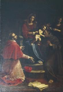 Thronende Madonna mit Kind, dem Heiligen Karl Borromäus und einem Franziskaner