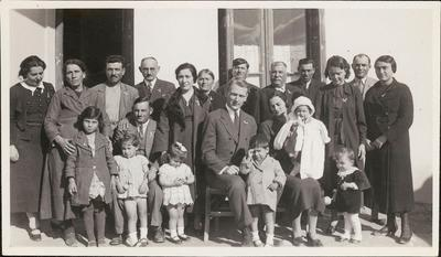 Image from object titled Family portait of the Lekkas family with Richard H. Howland at the christening of Lekkas's godchild