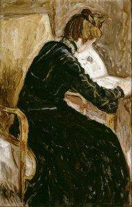 Lesende Frau im Lehnstuhl