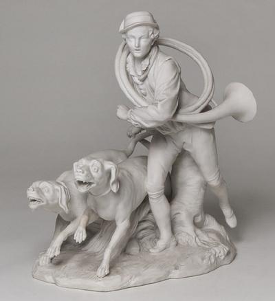 Grupp, drevkarl med jakthorn och två hundar