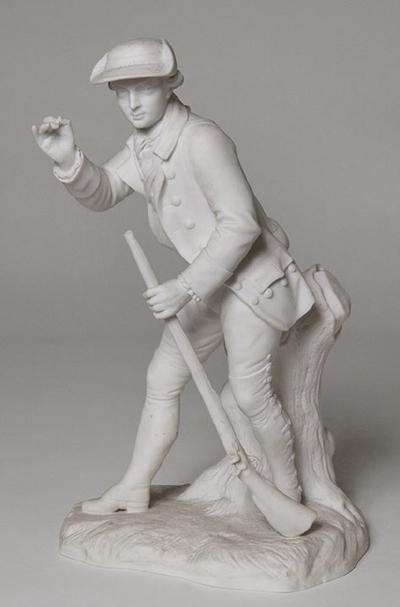 Statyett, jägare som laddar sin bössa