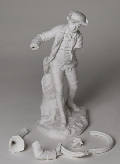 Statyett, drevkarl blåsande i jakthorn