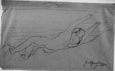 Kvinna liggande vid havet