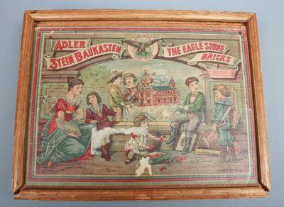 Image from object titled Een Adlersteenbouwdoos. De doos is van hout met een schuifdeksel.