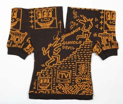 Ensemble van bruin en groen wollen tricot ingebreid met fantasiepatroon in oranje