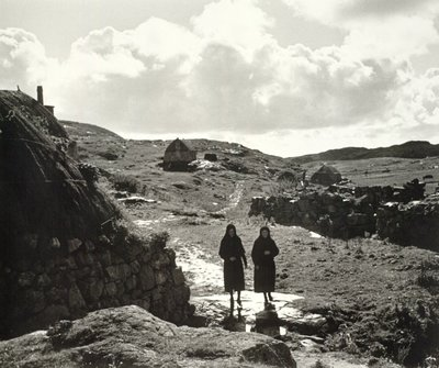 Dwelling houses and women in the landscape, Eriskay