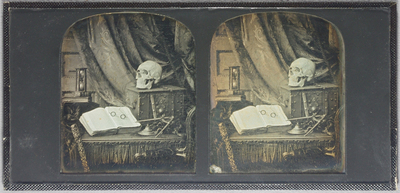 Image from object titled Stereo view, memento mori study depicting a table with open book upon it, reading glasses, metal strong-box on which a human skull and a key is placed, dividers on a velvet cloth, oil-lamp, pile of...