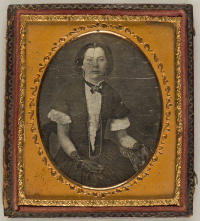 Image from object titled Portrait of a young woman with gloves