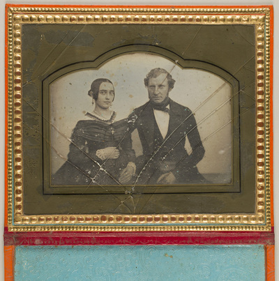 Image from object titled Casette in sleeve adjustable as a stand.; Portrait of a young couple, seated. MUDR. Pokorny with his wife.
