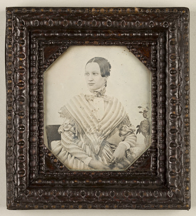 Image from object titled Possibly produced by the Prague studio of Wilhelm Horn, dated 1841 p.q., Voigtländer - Petzval camera plate.; Portrait of a woman in a striped dress, sitting on a chair, resting her left arm on a...