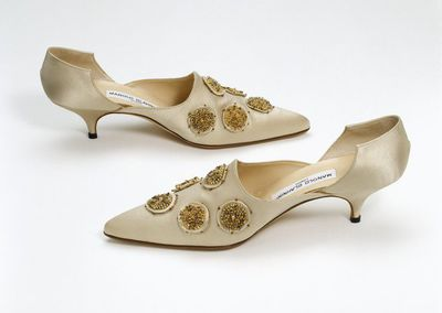 Cream beaded satin evening shoes with suede lining, designed by Manolo Blahnik, Great Britain, 1996.