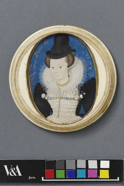Portrait miniature of an unknown woman, watercolour on vellum in a turned ivory box, painted by Nicholas Hilliard, 1602. Circular box of turned ivory.Watercolour on vellum stuck onto plain card;Turned ivory