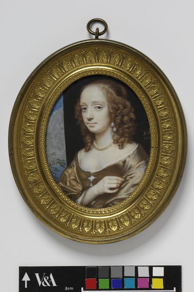 Portrait miniature of an unknown woman, called Lady Leigh, watercolour on vellum, painted by Samuel Cooper, 1648.Watercolour on vellum put down on a leaf from a table-book