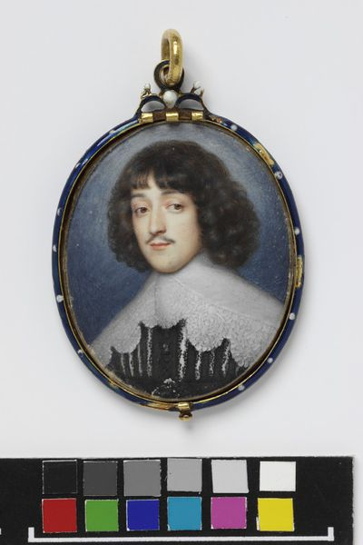 Portrait miniature of an unknown man in an oval locket, watercolour on vellum, painted by Alexander Cooper, 1635-1640.  ;Watercolour on vellum put down on a leaf from a table-book.;