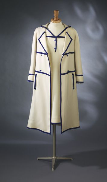 Cream wool worsted with blue plastic trim; Andr Courrges; French, 1965.