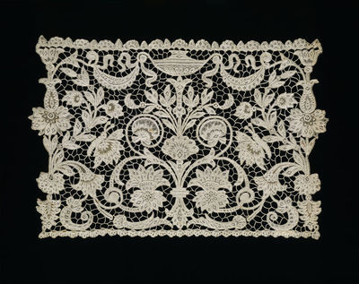 Part of a flounce, needle lace of floral and neoclassical design, designed by Michael Hayes, made by Presentation Convent, Youghal, Ireland, ca. 1886.Section of a flounce, needle lace of floral and neoclassical...