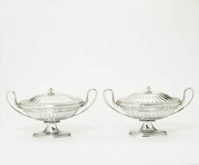 Pair of neoclassical silver sauce boats of shallow vase form with gadrooned bodies, marks of Matthew Boulton and James Fothergill, Birmingham, 1776-7.