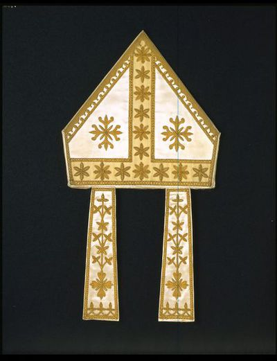 Mitre and mitre box, designed by A.W.N. Pugin, England, ca. 1848.Mitre of gold metal-thread embroidery on a silk ground, and mitre box.Gold metal-thread embroidery on silk.