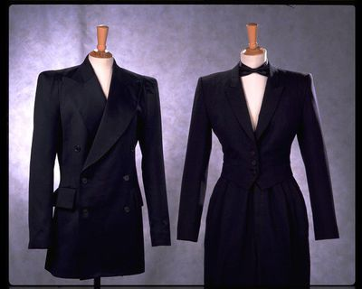 Black worsted suit with fitted jacket and tapered trousers, designed by Anthony Price, Great Britain, 1977-78.
