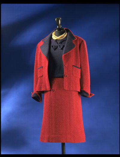 Wool tweed skirt and jacket with wool jersey trim and matching wool jersey top, designed by Chanel, France, ca. 1955.