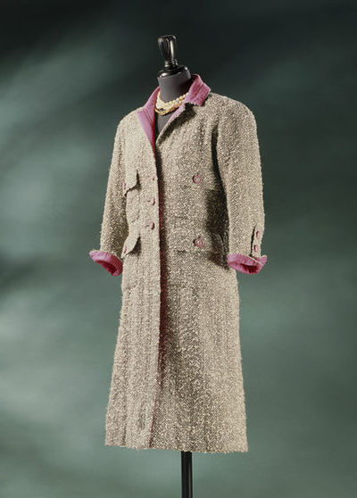 Bouclé wool tweed woman's coat, designed by Chanel, made in Paris, ca. 1965.