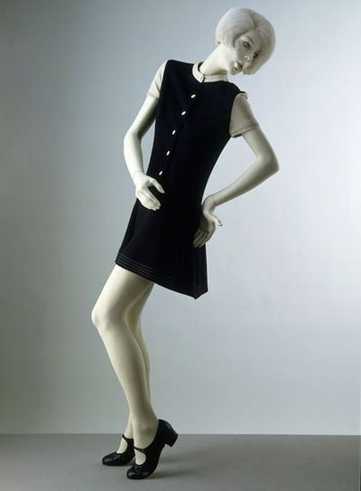 Mini-dress of wool and nylon jersey, designed by Mary Quant for Ginger Group, London, 1967. Mini-dress of bonded wool and nylon jersey. The short skirt is gently gathered into the low waist.  The short sleeves and neck...